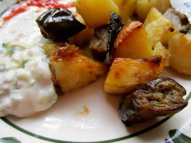 potatoes, aubergine, tzatziki and ketchup