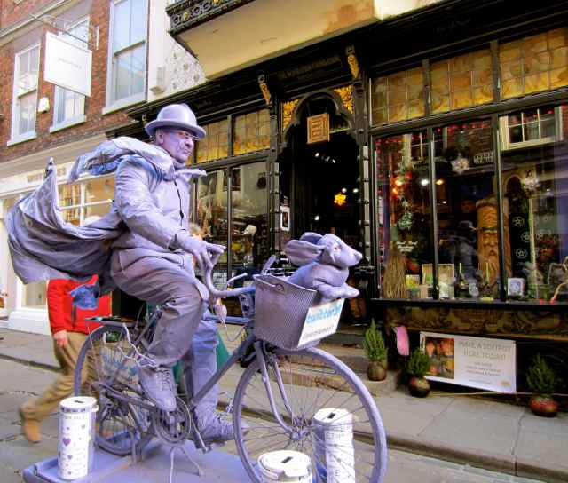 purple person on purple bike