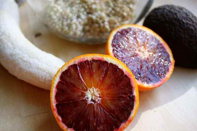 Blood oranges and banana close up