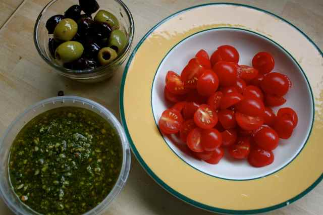 olives pesto and tomatoes