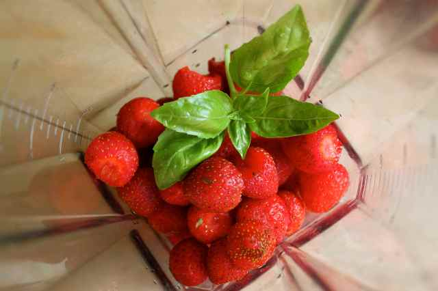 strawberries and basil in blender