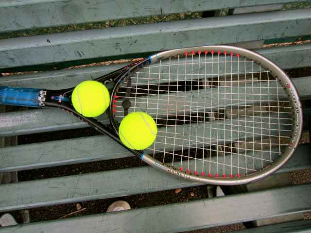 tennis racuet and balls