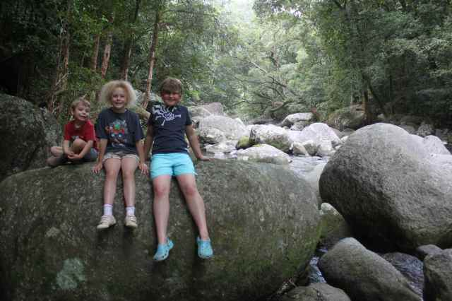 3 children on boulder