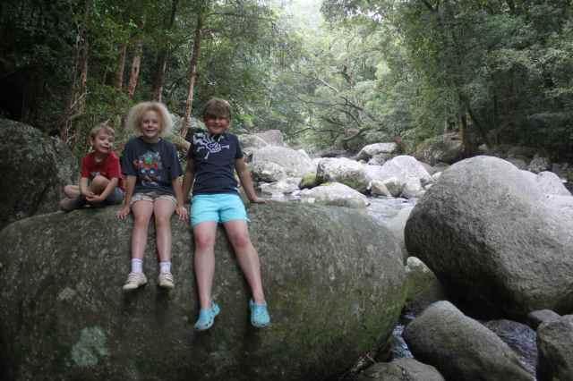 3 children on boulder