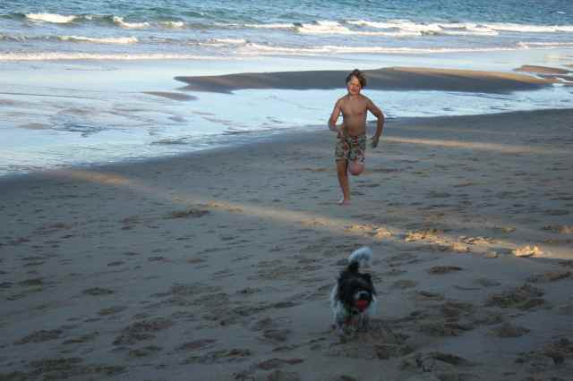 H and C on beach