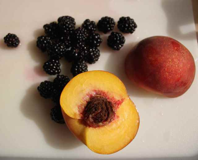 peach and blackberries