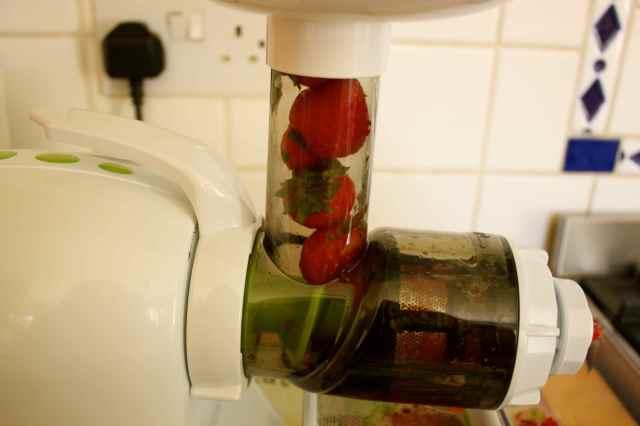 strawberries in juicer