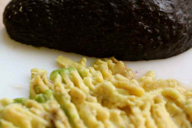 mashing avocado