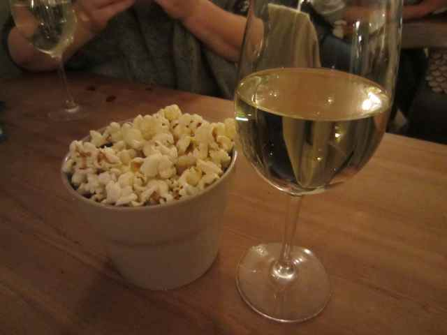white wine and popcorn