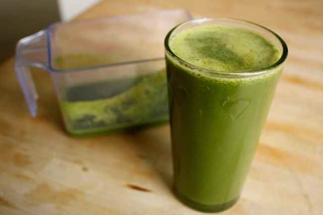 green juice in heart glass