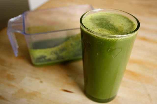 green juice in heart glass