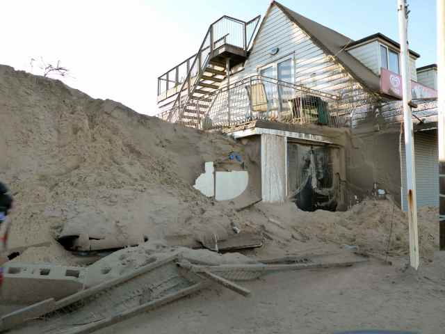 Sand on garage Camber