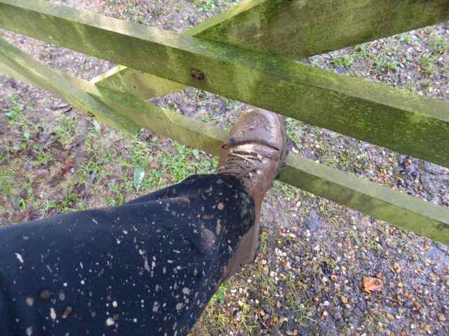 muddy boot on gate