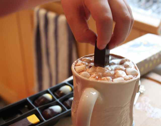 dipping chocolate in hot chocolate