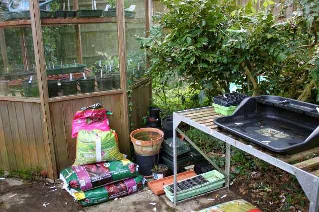 next to greenhouse