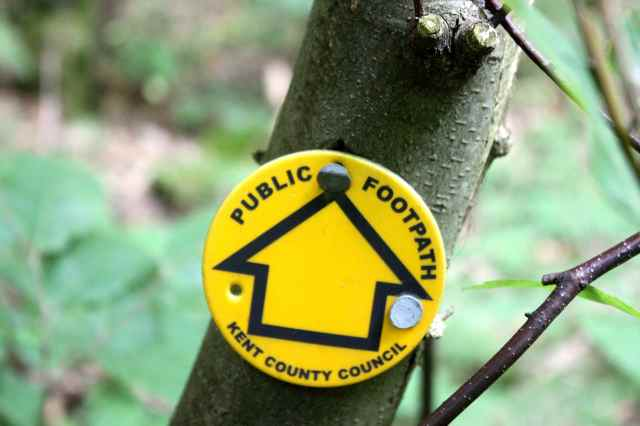 public footpath sign in woods