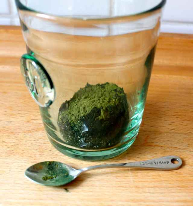 green powder in glass