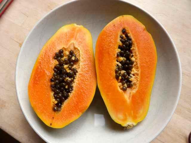 papaya in white bowl