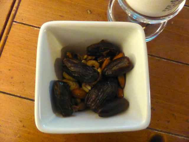 dates and nuts by candle